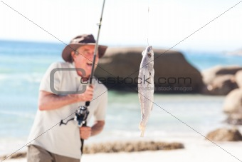 Man fishing at the beach
