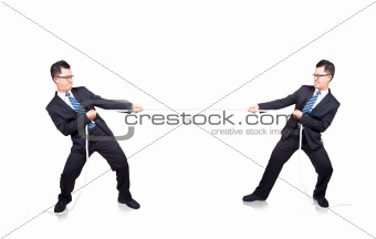 business man playing tug of war with himself