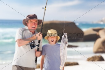 Man fishing with his grandson