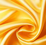 Smooth elegant golden satin as background