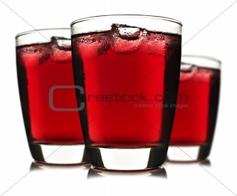 Three glasses of red fruit juice with ice