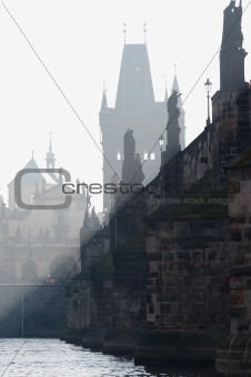 Charles bridge in the early morning fog