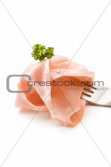 Fork with thin slice of mortadella