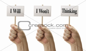 Three Signs In Male Fists Saying I Will, I Wont, Thinking Isolated on a White Background.
