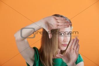 Beautiful Woman Framing Her Face