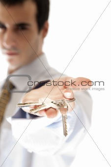 Business man showing key