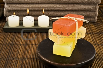 Soap candles and towels in a spa