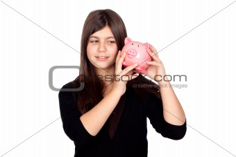 Adorable preteen girl with money box