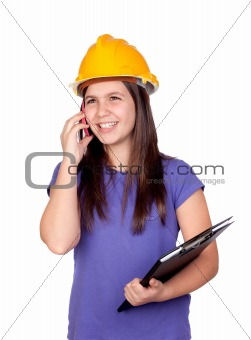 Adorable preteen girl with helmet and a mobile