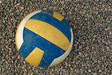 Volleyball on a gravel surface