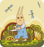 Easter rabbit with eggs in a basket