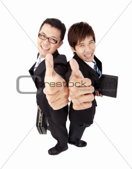 Two successful  businessman with thumb up
