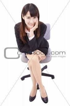 Portrait of beautiful business  woman sitting on chair isolated over white background