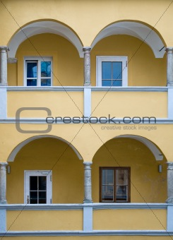 Arcade of a yellow baroque House