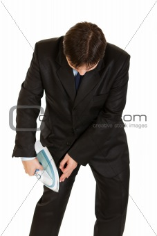 Businessman  ironing his business suit right on herself