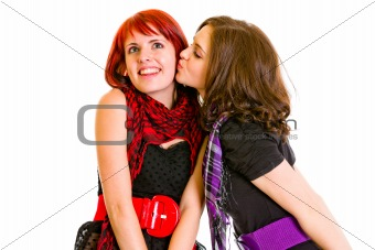 Young girl kissing her charming girlfriend
