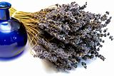 dried bouquet of fragrant lavender and blue bottle