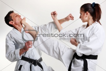 Karate. Young girl and a men in a kimono. Battle sports capture