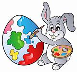 Bunny artist painting Easter egg