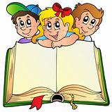 Three children with opened book