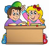 Two children at school desk