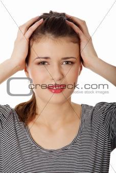 Teen woman with headache