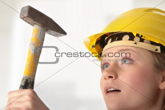 Beautiful girl in yellow helmet