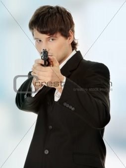 Businessman aiming with handgun
