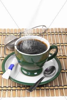 pour sugar into a mug