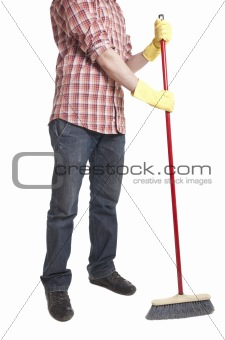 Full isolated studio picture from a young worker with a broom