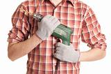 hands handling an electric drilling machine