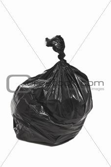 Black garbage bag isolated on white