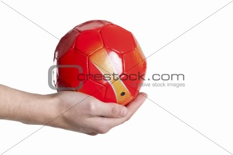 small soccer red ball in hand. Isolated on white