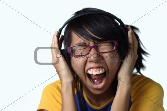 Asian teen lady screaming with headphones