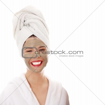 Cosmetics mask of clay on the beautiful young woman face