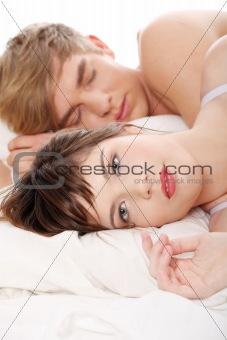 Beautiful young couple sleeping.