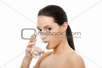 Beautiful young woman drinks clear mineral water