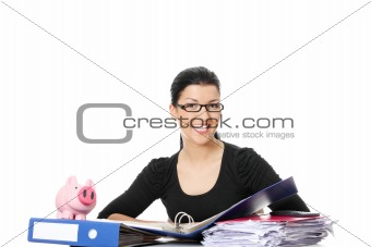 Smiling young woman sitting at the desk