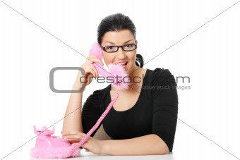Beautiful young happy caucasian woman on phone
