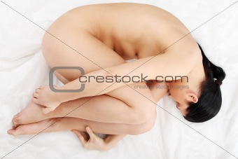 Young nude depressed woman