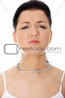 Young woman with barbed wire around her throat.