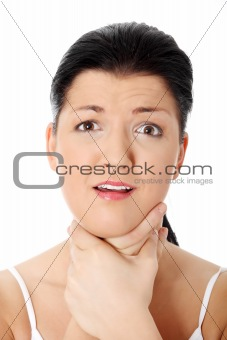 Young woman touching her throat.