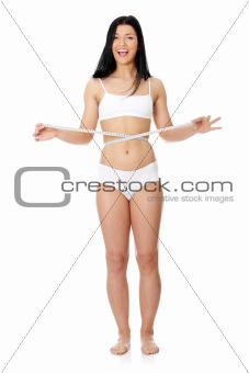 Sexy, young woman measuring her waist