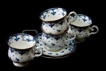 Four tea cups on saucer