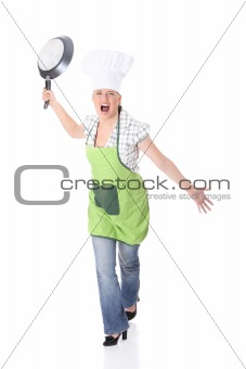Angry young woman cooking
