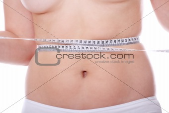 Female measuring her body