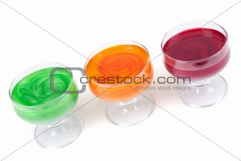 Green, yellow and red jelly in glass