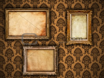 Gilded vintage frames on damask wallpaper background with grunge