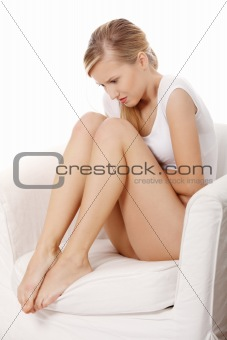 Young blond woman with stomach issues