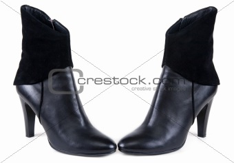 Black feminine leather boots with suede insertion